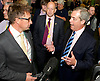 UKIP National Party Conference <br /> Day 2<br /> at Doncaster Race Course, Doncaster, Great Britain <br /> 27th September 2014 <br /> <br /> Nigel Farage <br /> walking through the exhibition area at the Conference <br /> talking to a journalist <br /> <br /> Photograph by Elliott Franks <br /> Image licensed to Elliott Franks Photography Services