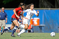 2 October 2011:  FIU's Ashleigh Shim (9) takes the ball to the goal while being defended by South Alabama's Tatum Perry (20) in the second half as the FIU Golden Panthers defeated the University of South Alabama Jaguars, 2-0, at University Park Stadium in Miami, Florida.
