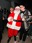 Ronin Zander and Rick Nielsen of Cheap Trick with Santa Claus at Alice Cooper's Christmas Pudding show for his Solid Rock Foundation Charity at Dodge Theatre in Phoenix, Arizona, December 18th 2004. Photo by Chris Walter/Photofeatures.