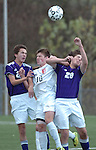 A Williamsport High School player is sanwiched between two Shamokin players.