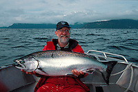 Dave Vedder with a 38 pound Chinook salmon caught in the Queen Charlotte Ilands, British Columbia, while fishing from Charlotte Queen Adventures, a floating lodge operation on a converted tugboat.