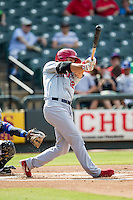 Memphis Redbirds third baseman Scott Moore (12) swings the bat during the first game of a Pacific Coast League doubleheader against the Round Rock Express on August 3, 2014 at the Dell Diamond in Round Rock, Texas. The Redbirds defeated the Express 4-0. (Andrew Woolley/Four Seam Images)