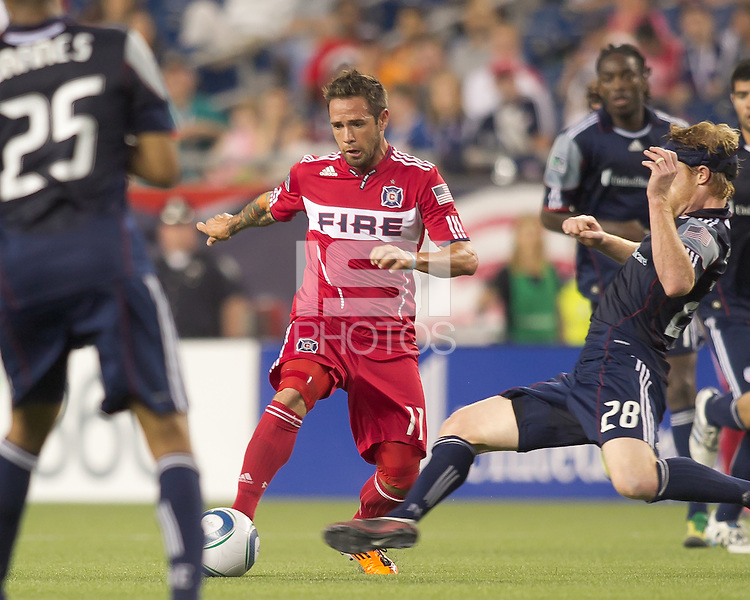Chicago Fire midfielder Daniel Paladini (11) dribbles at midfield. In a Major League Soccer (MLS) match, the New England Revolution tied the Chicago Fire, 1-1, at Gillette Stadium on June 18, 2011.