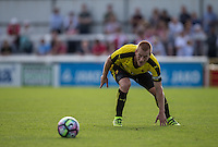 Ben Watson of Watford watches the ball roll out of reach during the Pre Season Friendly match between Woking and Watford at the Kingfield Stadium, Woking, England on 10 July 2016. Photo by Andy Rowland.