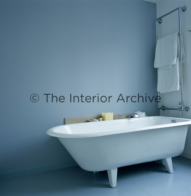 This bathroom is furnished with a traditionally shaped free-standing bath tub with plain feet and a mono-block tap