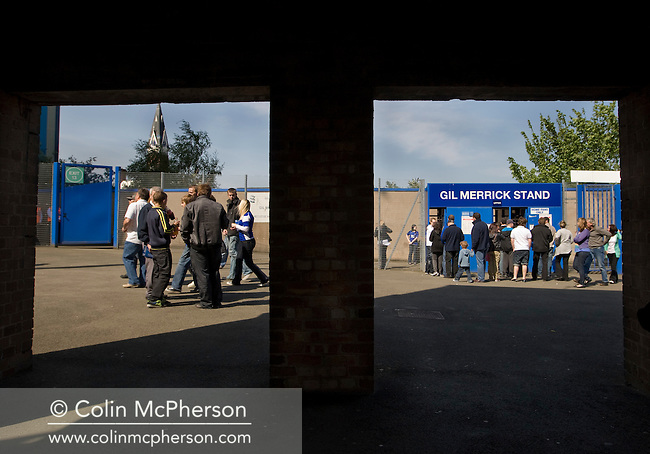 Home supporters making their way towards the turnstiles at the Gil Merrick stand at St. Andrew's stadium, prior to Birmingham City's Barclay's Premier League match with Wolverhampton Wanderers. Both clubs were battling against relegation from  England's top division. The match ended in a 1-1 draw, watched by a crowd of 26,027.