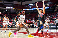 COLLEGE PARK, MD - FEBRUARY 9: Jordan Wallace #44 of Rutgers moves in to block Ashley Owusu #15 of Maryland during a game between Rutgers and Maryland at Xfinity Center on February 9, 2020 in College Park, Maryland.