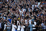 Tottenham Hotspur 4 Watford 0, 08/04/2017. White Hart Lane, Premier League. Supporters in the East Stand react with delight as the home team score their second goal as Tottenham Hotspur took on Watford in an English Premier League match at White Hart Lane. Spurs were due to make an announcement in April 2016 regarding when they would move out of their historic home and relocate to Wembley as their new stadium was completed. Spurs won this match 4-0 watched by a crowd of 31,706, a reduced attendance figure due to the ongoing ground redevelopment. Photo by Colin McPherson.