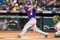LSU Tigers shortstop Alex Bregman (8) follows through on his swing during the NCAA baseball game against the Baylor Bears on March 7, 2015 in the Houston College Classic at Minute Maid Park in Houston, Texas. LSU defeated Baylor 2-0. (Andrew Woolley/Four Seam Images)