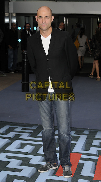 MARK STRONG .At the World Premiere of 'Inception' at the Odeon Leicester Square cinema, Leicester Square, London, England, .UK, July 8th 2010..arrivals full  length black suit jacket blazer t-shirt  white jeans .CAP/CAN.©Can Nguyen/Capital Pictures.