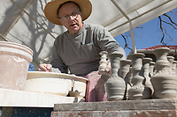 NWA Democrat-Gazette/CHARLIE KAIJO Potter John Bailey of Goshen molds a ceramic pot during a pottery demonstration, Thursday, March 21, 2019 at the Peel Mansion in Bentonville. <br />