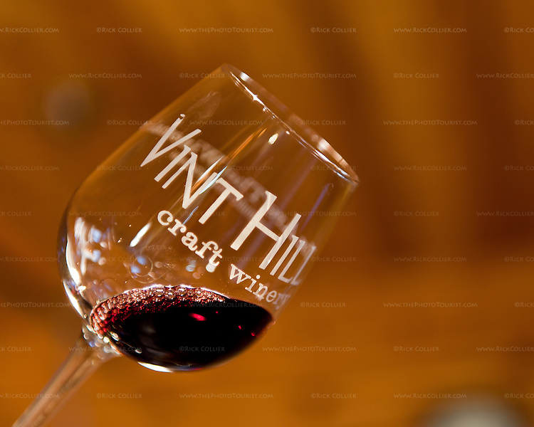A taste of red wine shows its color and clarity when held up to the light at Vint Hill Craft Winery, near Warrenton Virginia.