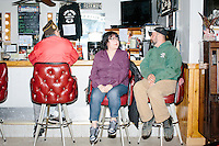 Post commander Ray Marotte (red), wife Josephine Marotte (purple) and Timmy Fortier (green), all of Raymond, NH, sit at the bar before Ohio governor and Republican presidential candidate John Kasich speaks at a town hall campaign event at Raymond VFW Post 4479 in Raymond, New Hampshire, on Wed., Feb. 3, 2016.