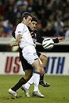 6 November 2004: Steve Ralston (front) and Alecko Eskandarian (behind) challenge for the ball. DC United defeated the New England Revolution 4-3 on penalties after the game ended in a 3-3 tie at RFK Stadium in Washington, DC in the Major League Soccer Eastern Conference Championship Match. .
