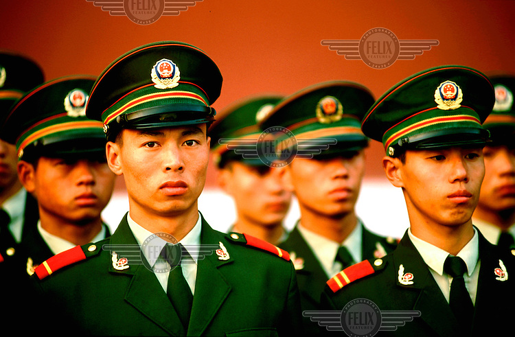 Mark Henley/Panos Pictures..China, Beijing..PLA soldiers at attention in front of Tiananmen Gate.