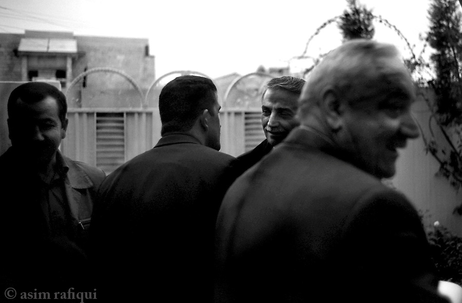 irbeel, northern iraq, january 2005: yonadam kanna, (second from right),  leader of the assyrian democractive movement (ADM) and candidate in the iraqi elections and national parliament, greets members of the ADM at an all-party meeting in irbeel<br />