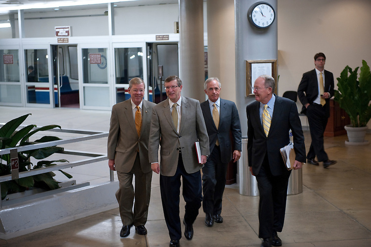 UNITED STATES - August 2:  Johnny Isakson, R-GA., Kent Conrad, D-ND., Bob Corker, R-TN., and Lamar Alexander, R-TN.,  talk as they enter the U.S. Capitol from the Senate subway on August 2, 2011. (Photo By Douglas Graham/Roll Call)