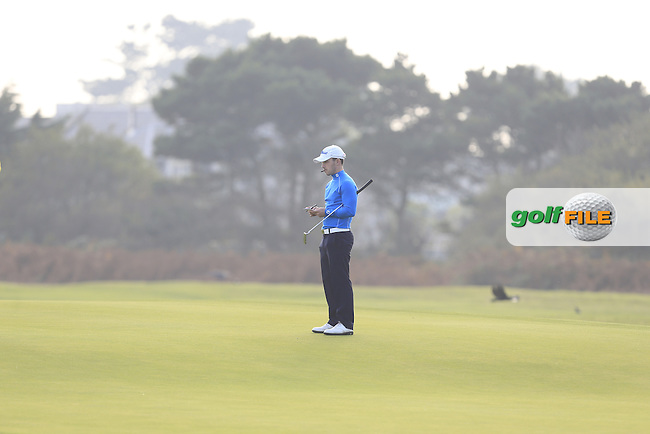 Daniel Holland (DIT) on the 16th green during Round 1 of the Irish Intervarsity Championship at Rosslare Golf Club on Wednesday 4th November 2015.<br /> Picture:  Thos Caffrey / www.golffile.ie