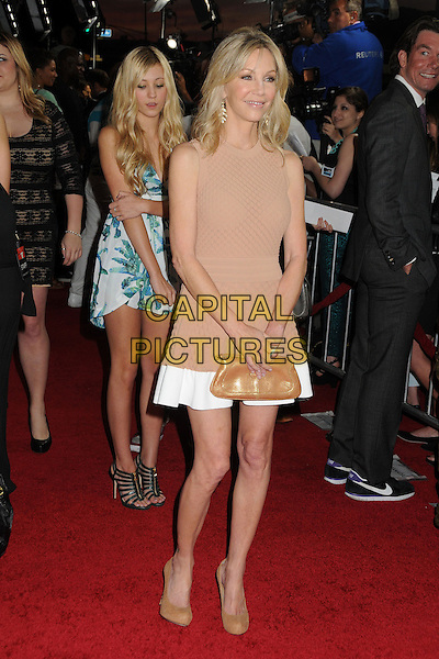 "Heather Locklear.Attending the ""Scary Movie 5"" Los Angeles film premiere held at the Cinerama Dome,  Hollywood, California, USA, .11th April 2013..full length dress white trim brown clutch bag shoes nude beige sleeveless .CAP/ADM/BP.©Byron Purvis/AdMedia/Capital Pictures"