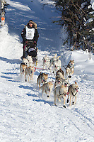 Justin Savidis on Long Lake at the Re-Start of the 2012 Iditarod Sled Dog Race