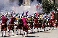 Valletta, Malta. Participants in Costume firing Muskets for Historic In Guardia Re-enactment, Fort Saint Elmo.