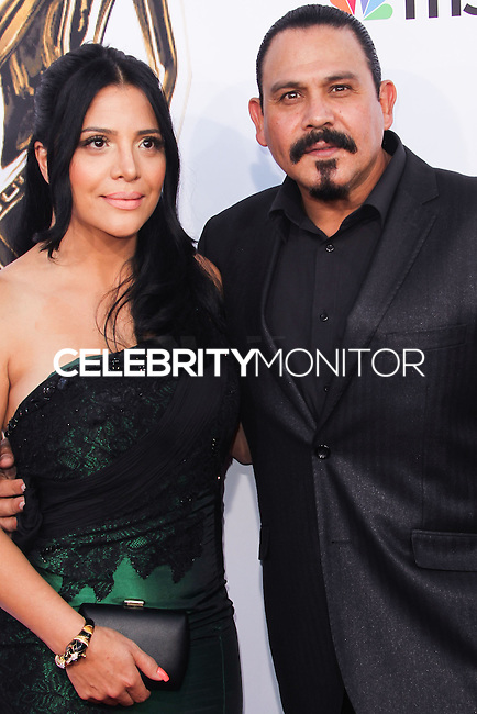 PASADENA, CA, USA - OCTOBER 10: Emilio Rivera, Yadi Valerio arrive at the 2014 NCLR ALMA Awards held at the Pasadena Civic Auditorium on October 10, 2014 in Pasadena, California, United States. (Photo by Celebrity Monitor)