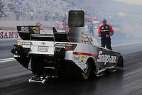 Apr. 5, 2013; Las Vegas, NV, USA: NHRA crew member guides funny car driver Cruz Pedregon back to the starting line before a run during qualifying for the Summitracing.com Nationals at the Strip at Las Vegas Motor Speedway. Mandatory Credit: Mark J. Rebilas-