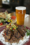 Red beans, Rice with sasuage (front), goat cheese salad served with Snoqualmie Wildcat IPA at Queen Anne's Hilltop Alehouse. Jim Bryant Photo.