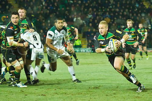 Shane Geraghty makes a break.  Northampton Saints v London Irish, Aviva Premiership, 26 November 2010 at Franklin's Gardens.  Final score: Northampton Saints 35-23 London Irish.