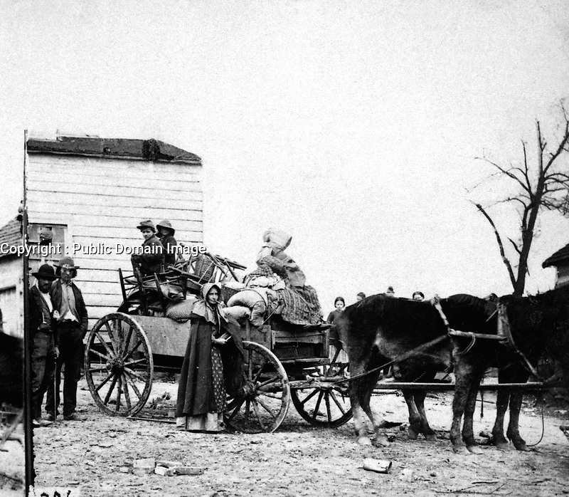 Refugees leaving the Old Homestead.  Union families persecuted by the Rebels would hastily gather up a little furniture, pile it on to an old wagon, and take up their march northward toward the land of freedom.  Stereo.  (National Archives Gift Collection)<br /> Exact Date Shot Unknown<br /> NARA FILE #:  200-CC-306<br /> WAR & CONFLICT BOOK #:  172