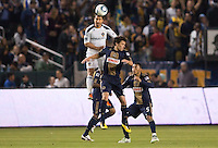 LA Galaxy forward Juan Pablo Angel (9) goes high over Philadelphia Union midfielder Stefani Miglioranzi (6). The LA Galaxy defeated the Philadelphia Union 1-0 at Home Depot Center stadium in Carson, California on  April  2, 2011....