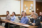 Gary Coombs listens to students in his learning community class give presentations on October 19, 2016.