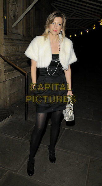 CLAIRE GOOSE.The Christmas Carols with the Stars festive concert, Royal Albert Hall, London, England..December 8th, 2008.full length black dress white fur jacket bag purse silver tights .CAP/CAN.©Can Nguyen/Capital Pictures.