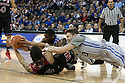 December 8, 2013: Terran Petteway (5) of the Nebraska Cornhuskers and Grant Gibbs (10) of the Creighton Bluejays scramble for the ball and get into a fight getting them both removed from the game at the CenturyLink Center in Omaha, Nebraska. Creighton defeated Nebraska 82 to 67.