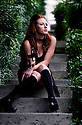 Red headed party girl drinking wine on garden steps. Black knee highs, heels and scarf.  Thrift store fashion finds. Vintage Couture.  Eco Fashion, fashionista, reduce, reuse, recycle, Refashion.