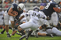 06 October 2012:  Penn State RB Zach Zwinak (28) takes a hit from Northwestern's Tyler Scott (97) and fights toward the end zone. The Penn State Nittany Lions defeated the Northwestern Wildcats 39-28 at Beaver Stadium in State College, PA.