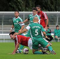 In der NRW-Liga spielt der VfB H&uuml;ls (in rot) am Sonntag, 19.09.10, in Marl gegen den VFB Speldorf, hier wird Marls Timur Karag&uuml;lmez, liegend, gefoult. Das Spiel endete 2:0 f&uuml;r den VfB H&uuml;ls.<br /> Foto: Rainer Raffalski / WAZ FotoPool
