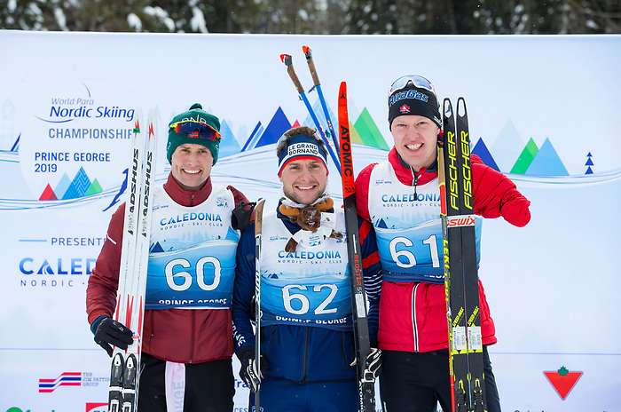 Prince George, B.-C., 16 February/2019  - (l to r) Nils-Erik Ulset NOR silver, Benjamin Daviet FRA (gold) and Mark Arendz  wins the bronze medal in the men's standing middle distance biathlon on day 01 of the 2019 World Para Nordic skiing Championships in Prince George, B.C. Photo Bob Frid/Canadian Paralympic Committee.
