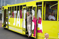 Tour bus at Manufactura entertainment center. Man at door and boy MR. Balucki District Lodz Central Poland