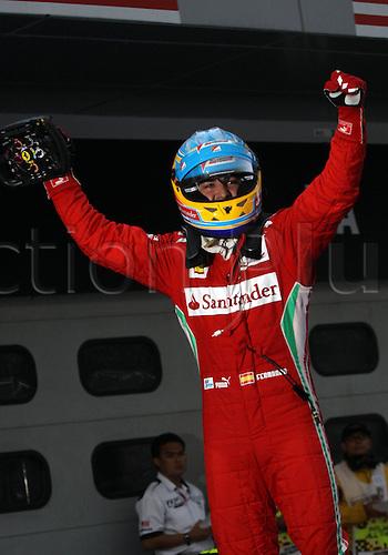 25.03.2012. Kuala Lumpur Malaysia.  Formula 1 GP Malaysia in Kuala Lumpur  Fernando Alonso Scuderia Ferrari jumps from his car to celebrate his win