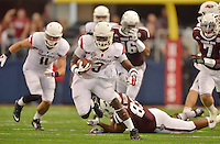 STAFF PHOTO BEN GOFF  @NWABenGoff -- 09/27/14 Arkansas running back Alex Collins runs for a touchdown during the second quarter of the game against Texas A&M in the Southwest Classic in AT&T Stadium in Arlington, Texas on Saturday September 27, 2014.