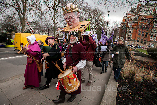 London, 23/02/2015. Today, the &quot;Justice Alliance&quot; and their Chris Grayling puppet dresses as King John Lackland arrived in Westminster for the last day of a tree-day march called &quot;Relay For Rights&quot; from Runnymede, birth place of the Magna Carta, to Old Palace Yard, where they held the &quot;Not the Global Law Summit&quot; rally. At the end of the demonstration outside the Houses of Parliament, protesters marched peacefully to the Queen Elizabeth II Centre where the &quot;Global Law Summit&quot; was taking place. From the organisers Facebook page: &lt;&lt; [&hellip;] February 23rd 2015 is the 799th and 8 month anniversary of the signing of the Magna Carta. The Government is using this non-anniversary to host the Global Law Summit, &quot;a unique opportunity to explore what the future holds for global business and the rule of law&quot;. This back-slapping corporate jamboree, partly funded by the Ministry of Justice, comes at a time when the same department has waged a slash-and-burn campaign on advice and representation, leaving people without deep pockets unable to get justice in court. Magna Carta represents the oldest historical commitment to equal access to justice in Britain. We are here to remind the Government of its duty to provide access to justice for all, and not merely to the rich. [&hellip;]&gt;&gt;<br />