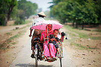 Myanmar Rohingya people are driven on a rickshaw on a road north of the town of Sittwe May 18, 2012. REUTERS/Damir Sagolj (MYANMAR)