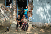 Rani Barukaum, the SHG group leader and her children pose for a portrait in the courtyard of her house in Ambedkar Nagar in Medak, Telangana, India.
