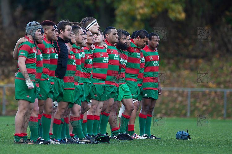 Waiuku stand for the National anthem before the Counties Manukau McNamara Cup Premier Club Rugby final between Pukekohe andWaiuku, held at Bayer Growers Stadium, on Saturday July 17th. Waiuku won 25 - 20.