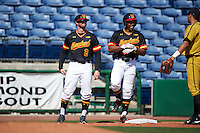 Maryland Terrapins hitting coach Rob Vaughn (2) and right fielder Marty Costes (42) talk with third baseman Ray Hernandez (right) after a triple by Costes during a game against the Alabama State Hornets on February 19, 2017 at Spectrum Field in Clearwater, Florida.  Maryland defeated Alabama State 9-7.  (Mike Janes/Four Seam Images)