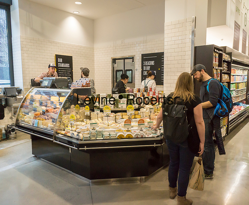 Cheese department in the new Whole Foods Market in Newark, NJ on opening day Wednesday, March 1, 2017. The store is the chain's 17th store to open in New Jersey. The 29,000 square foot store located in the redeveloped former Hahne & Co. department store building is seen as a harbinger of the revitalization of Newark which never fully recovered from the riots in the 1960's.  (© Richard B. Levine)