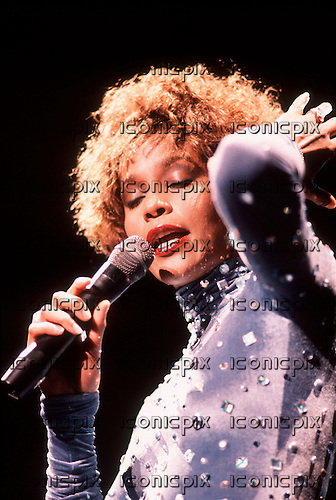 Whitney Houston - performing live on the I'm Your Baby Tonight World Tour at the NEC Arena in Birmingham UK - 28 Aug 1991.  Photo credit: George Chin/IconicPix