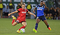 Portland, Oregon - Saturday July 9, 2016: Portland Thorns FC forward Hayley Raso (21) takes a hot in front of FC Kansas City forward Tiffany McCarty (20) during a regular season National Women's Soccer League (NWSL) match at Providence Park.