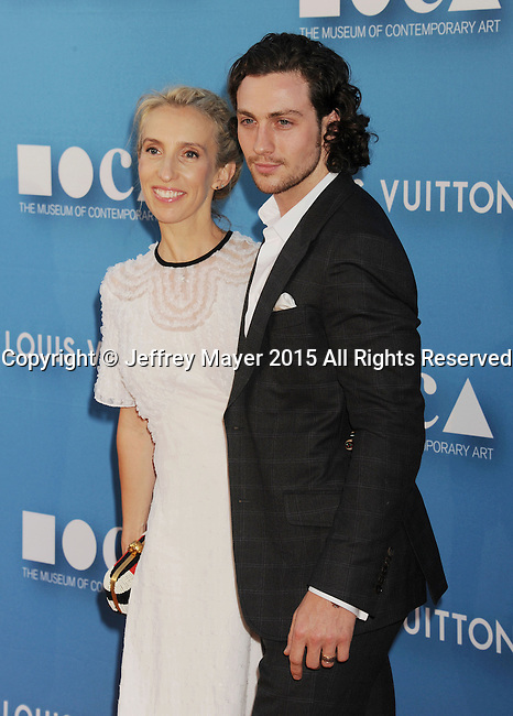LOS ANGELES, CA - MAY 30: Actor Aaron Taylor-Johnson (R) and wife filmmaker Sam Taylor-Johnson arrive at the 2015 MOCA Gala presented by Louis Vuitton at The Geffen Contemporary at MOCA on May 30, 2015 in Los Angeles, California.